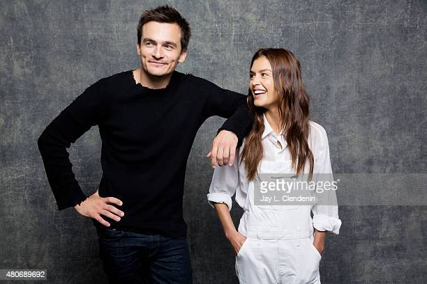Actors Rupert Friend and Hannah Ware of 'Hitman Agent 47' pose for a portrait at ComicCon International 2015 for Los Angeles Times on July 9 2015 in...