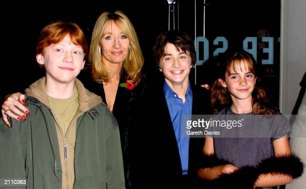 Actors Rupert Grint Author JK Rowling Daniel Radcliffe and Emma Watson attend the world premiere of the first Harry Potter film 'Harry Potter and the...