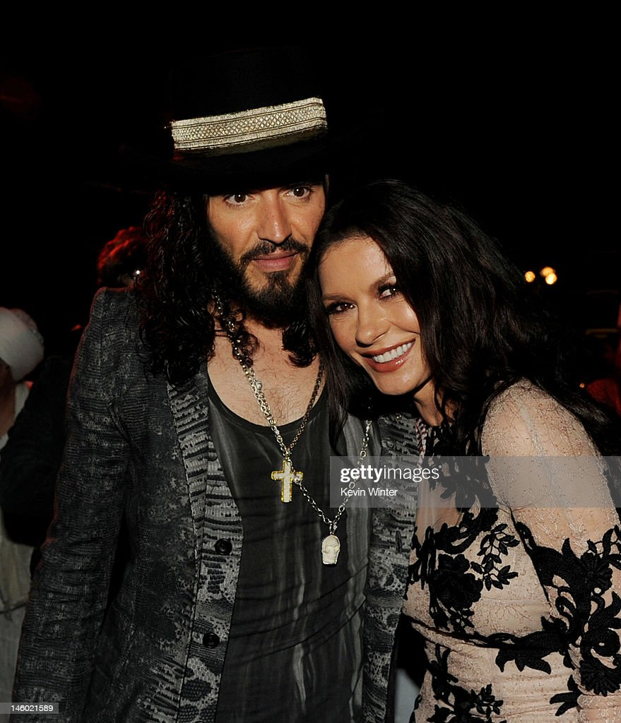 Actors <a gi-track='captionPersonalityLinkClicked' href=/galleries/search?phrase=Russell+Brand&family=editorial&specificpeople=536593 ng-click='$event.stopPropagation()'>Russell Brand</a> (L) and <a gi-track='captionPersonalityLinkClicked' href=/galleries/search?phrase=Catherine+Zeta-Jones&family=editorial&specificpeople=167111 ng-click='$event.stopPropagation()'>Catherine Zeta-Jones</a> pose at the after party for the premiere of Warner Bros. Pictures' 'Rock Of Ages' at Hollywood and Highland on June 8, 2012 in Los Angeles, California.