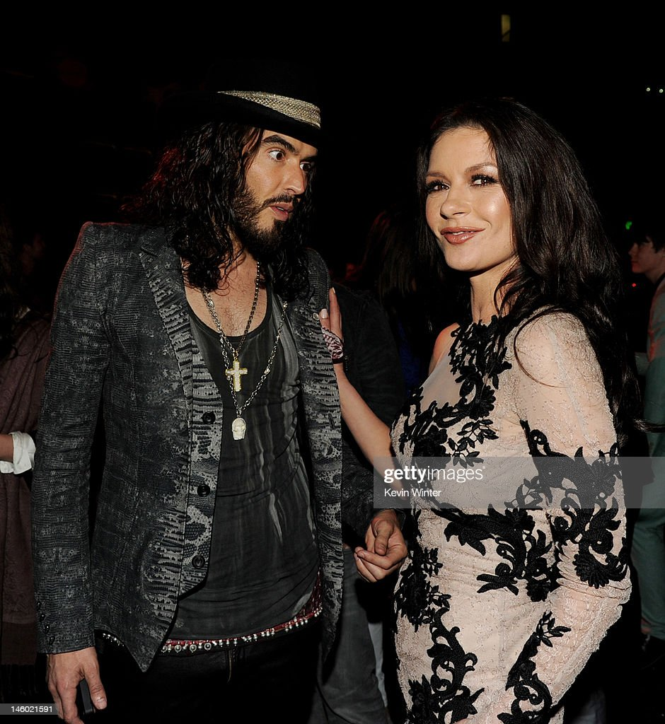 Actors Russell Brand (L) and Catherine Zeta-Jones pose at the after party for the premiere of Warner Bros. Pictures' 'Rock Of Ages' at Hollywood and Highland on June 8, 2012 in Los Angeles, California.