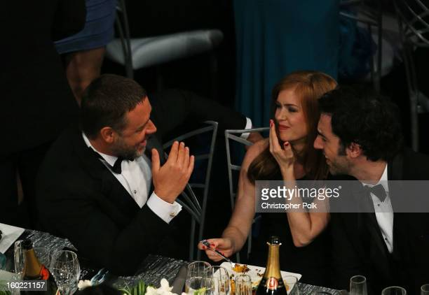 Actors Russell Crowe Isla Fisher and BJ Novak attend the 19th Annual Screen Actors Guild Awards at The Shrine Auditorium on January 27 2013 in Los...