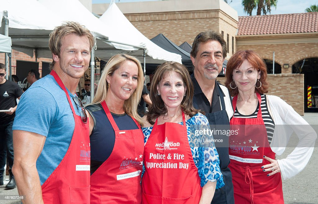 Actors Rusty Joiner Erin Murphy Kate Linder Joe Mantegna and Marilu Henner dressed and ready to serve police officers and firefighters at the...