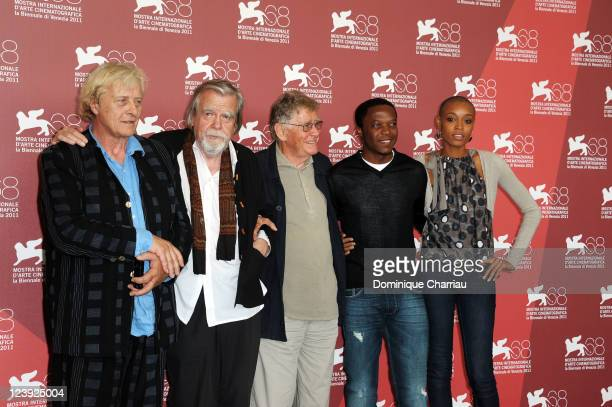 Actors Rutger Hauer Michael Lonsdale director Ermanno Olmi actors Blaise Essoua and Irima Pino Viney attend the 'Il Villaggio di Cartone' Photocall...