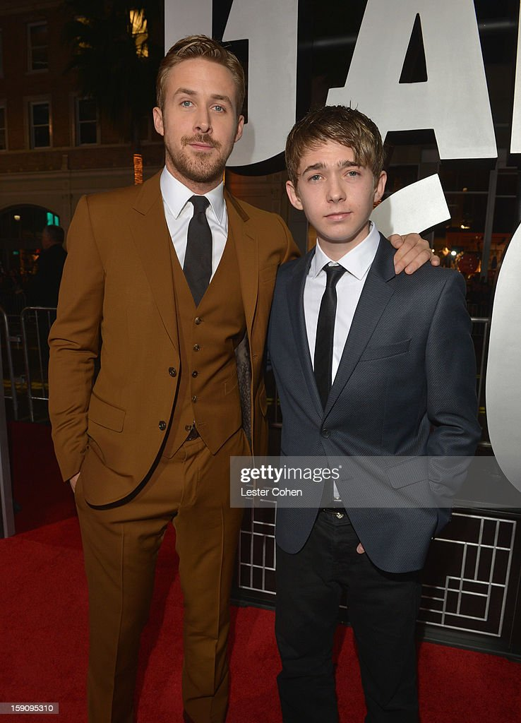 Actors <a gi-track='captionPersonalityLinkClicked' href=/galleries/search?phrase=Ryan+Gosling&family=editorial&specificpeople=214557 ng-click='$event.stopPropagation()'>Ryan Gosling</a> and Austin Abrams arrive at the 'Gangster Squad' premiere at Grauman's Chinese Theatre on January 7, 2013 in Hollywood, California.