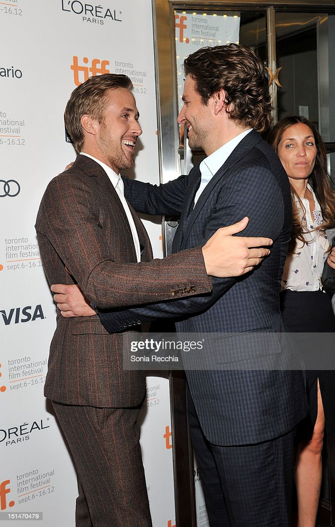 Actors (L-R) Ryan Gosling and Bradley Cooper attend 'The Place Beyond The Pines' premiere during the 2012 Toronto International Film Festival at Princess of Wales Theatre on September 7, 2012 in Toronto, Canada.