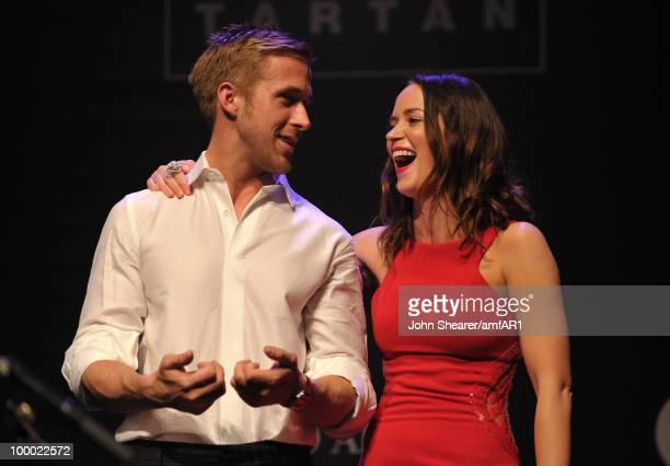 Actors Ryan Gosling and Emily Blunt speak at amfAR's Cinema Against AIDS 2010 benefit gala dinner at the Hotel du Cap on May 20 2010 in Antibes France