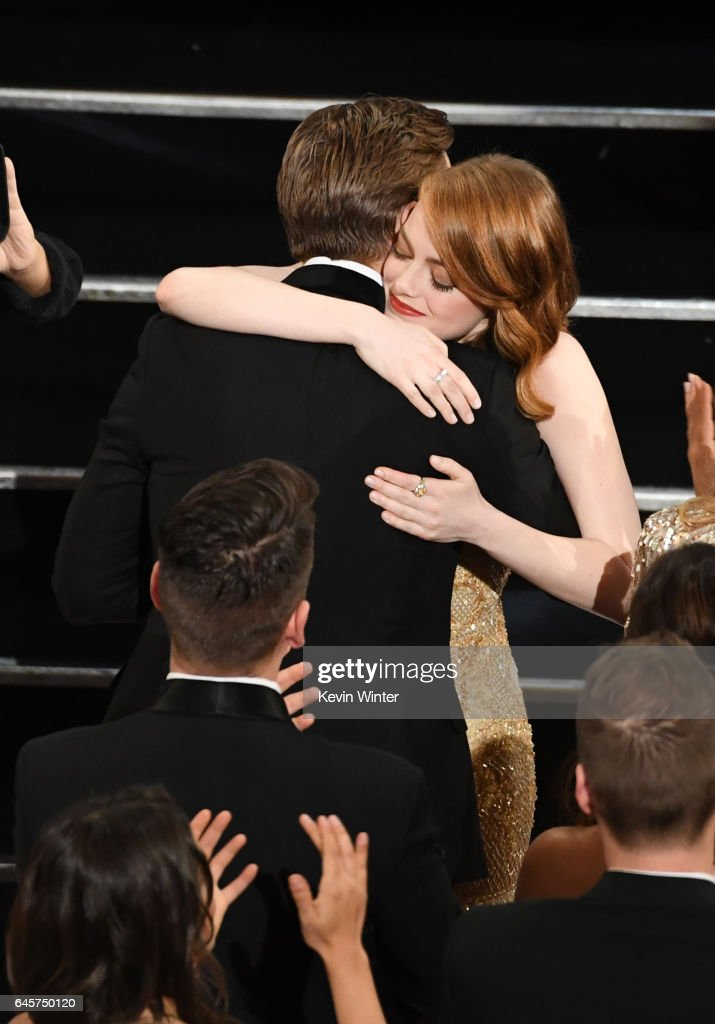 Actors Ryan Gosling (L) and Emma Stone embrace in the audience during the 89th Annual Academy Awards at Hollywood & Highland Center on February 26, 2017 in Hollywood, California.