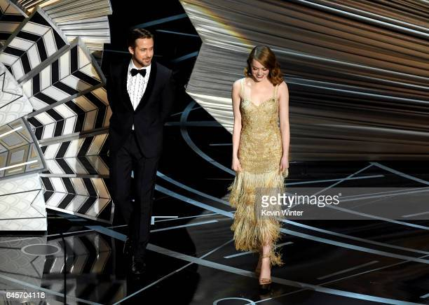 Actors Ryan Gosling and Emma Stone walk onstage during the 89th Annual Academy Awards at Hollywood Highland Center on February 26 2017 in Hollywood...