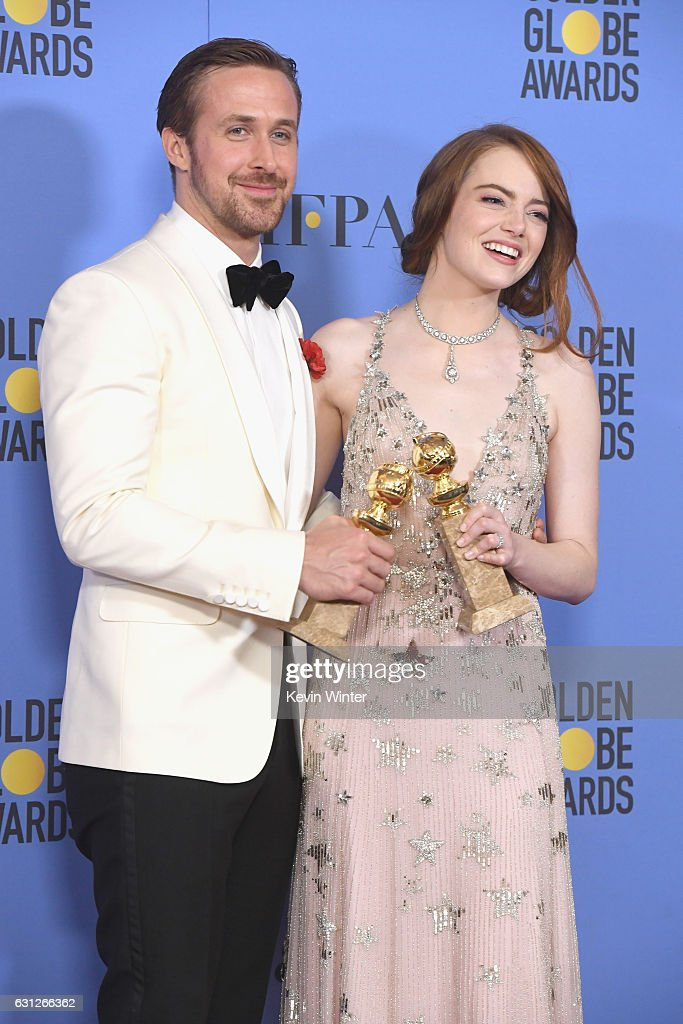 Actors Ryan Gosling and Emma Stone, winners for Best Actor and Best Actress in a Musical or Comedy Film for 'La La Land', pose in the press room during the 74th Annual Golden Globe Awards at The Beverly Hilton Hotel on January 8, 2017 in Beverly Hills, California.