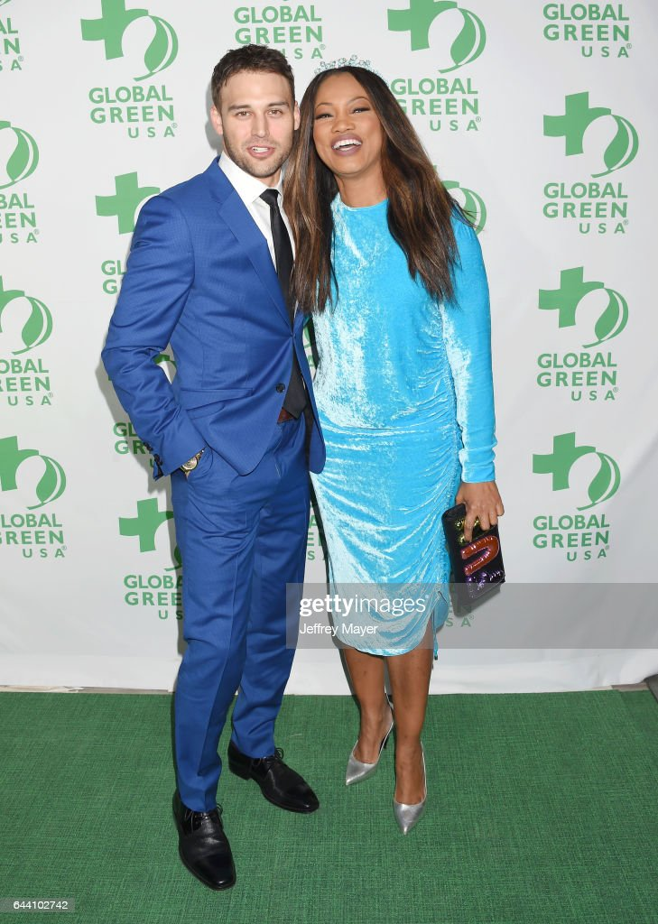 Actors Ryan Guzman (L) and Garcelle Beauvais arrive at the 14th Annual Global Green Pre-Oscar Gala at TAO Hollywood on February 22, 2017 in Los Angeles, California.