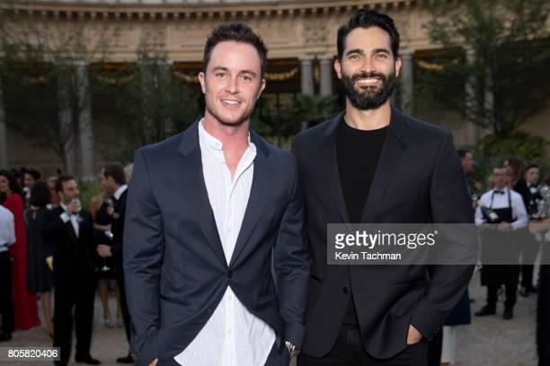 Actors Ryan Kelley and Tyler Hoechlin arrive for the amfAR Paris Dinner at Le Petit Palais on July 2 2017 in Paris France