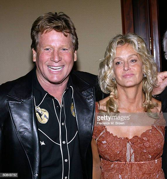 Actors Ryan O' Neal and Farrah Fawcett attend the Share Inc 51st Annual Boomtown Party at the Century Plaza Hotel Spa on May 15 2004 in Century City...