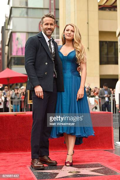 Actors Ryan Reynolds and Blake Lively pose for a photo as Ryan Reynolds is honored with star on the Hollywood Walk of Fame on December 15 2016 in...