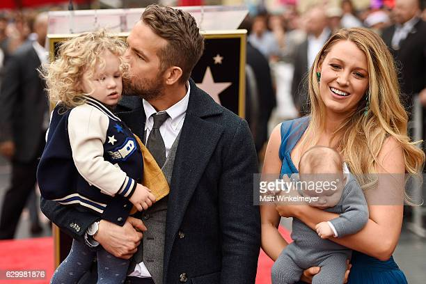 Actors Ryan Reynolds and Blake Lively pose with their daughters as Ryan Reynolds is honored with star on the Hollywood Walk of Fame on December 15...