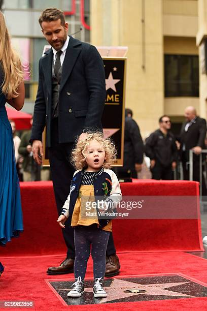 Actors Ryan Reynolds pose for a photo with his daughter James Reynolds as Ryan Reynolds is honored with star on the Hollywood Walk of Fame on...