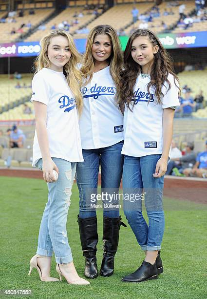 Actors Sabrina Carpenter Danielle Fishel and Rowan Blanchard on the field before the game between the Colorado Rockies and Los Angeles Dodgers at...
