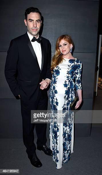 Actors Sacha Baron Cohen and Isla Fisher attend the 2015 Vanity Fair Oscar Party hosted by Graydon Carter at the Wallis Annenberg Center for the...