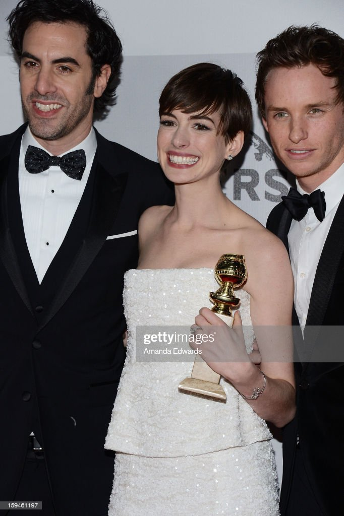 Actors Sacha Baron Cohen, Anne Hathaway and Eddie Redmayne arrive at the NBC Universal's 70th Golden Globes After Party at The Beverly Hilton Hotel on January 13, 2013 in Beverly Hills, California.