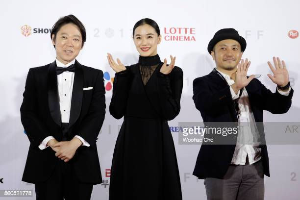 Actors Sadao Abe Yu Aoi and director Kazuya Shiraishi attend the Opening Ceremony of the 22nd Busan International Film Festival on October 12 2017 in...