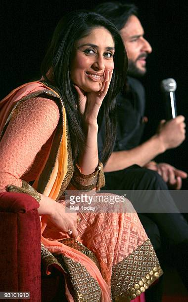Actors Saif Ali Khan and Kareena Kapoor interact with the media during a press conference for their forthcoming film Qurbaan in New Delhi on Saturday...