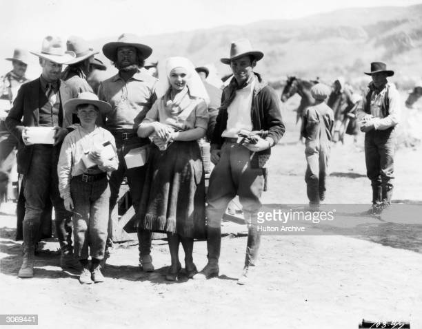 Actors Sally Blane Jack Holt and his son Tim Holt on location in the southwest Utah desert to film Paramount's 'The Vanishing Pioneer' directed by...
