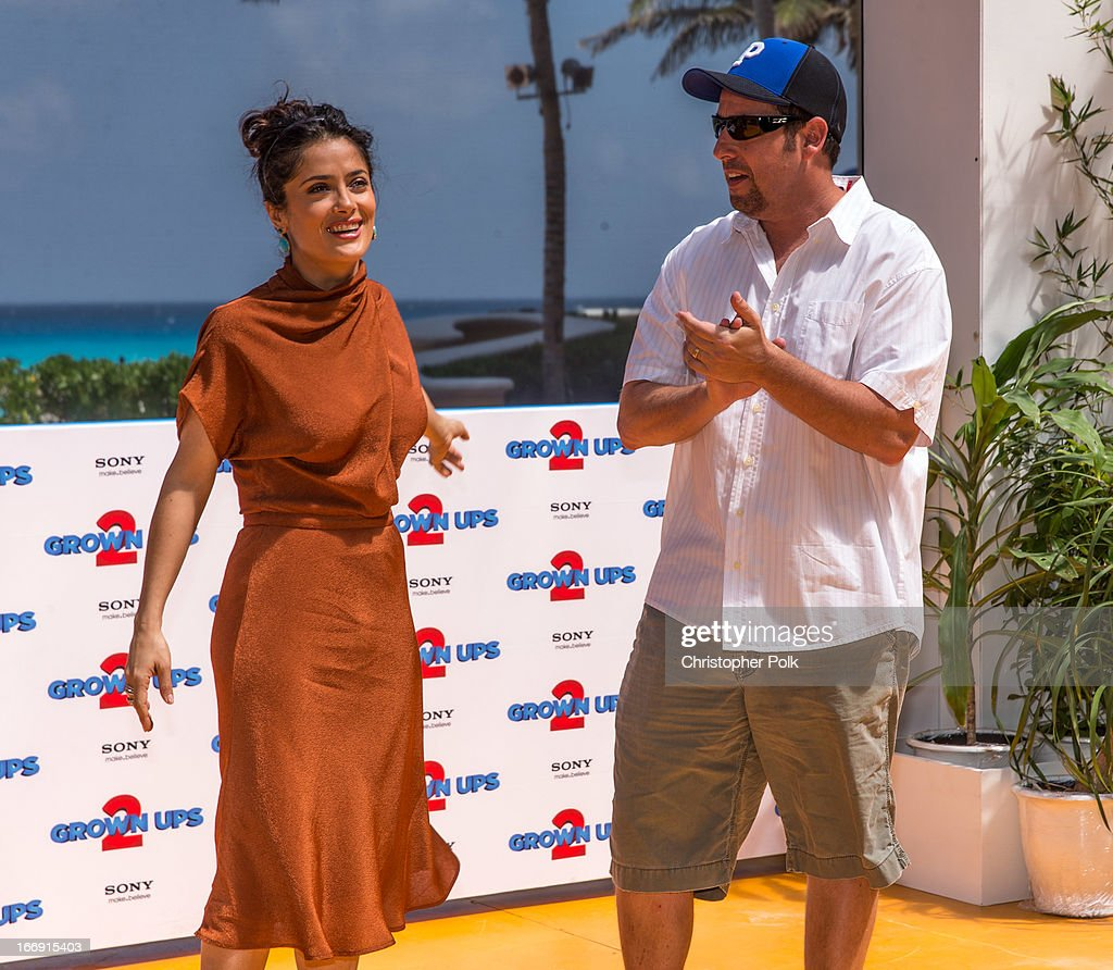 Actors Salma Hayek and Adam Sandler attend 'Grown Ups 2' Photo Call at The 5th Annual Summer Of Sony at the Ritz Carlton Hotel on April 18, 2013 in Cancun, Mexico.
