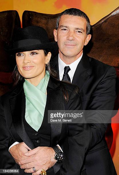 Actors Salma Hayek and Antonio Banderas arrive at the UK Premiere of 'Puss In Boots' at Empire Leicester Square on November 24 2011 in London England