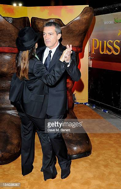 Actors Salma Hayek and Antonio Banderas dance at the UK Premiere of 'Puss In Boots' at Empire Leicester Square on November 24 2011 in London England