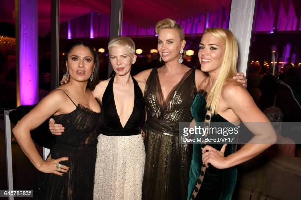 Actors Salma Hayek Michelle Williams Charlize Theron and Busy Philipps attend the 2017 Vanity Fair Oscar Party hosted by Graydon Carter at Wallis...
