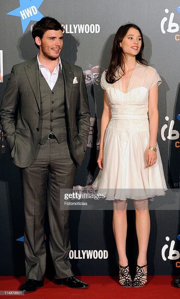 Actors Sam Claflin (R) and Astrid Berges-Frisbey attend 'Pirates Of The Caribbean: On Stranger Tides' premiere at Kinepolis Cinema on May 18, 2011 in Madrid, Spain.
