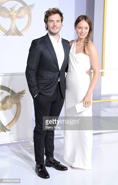 Actors Sam Claflin and Laura Haddock arrive at the Los Angeles Premiere 'the Hunger Games Mockingjay Part 1' at Nokia Theatre LA Live on November 17...