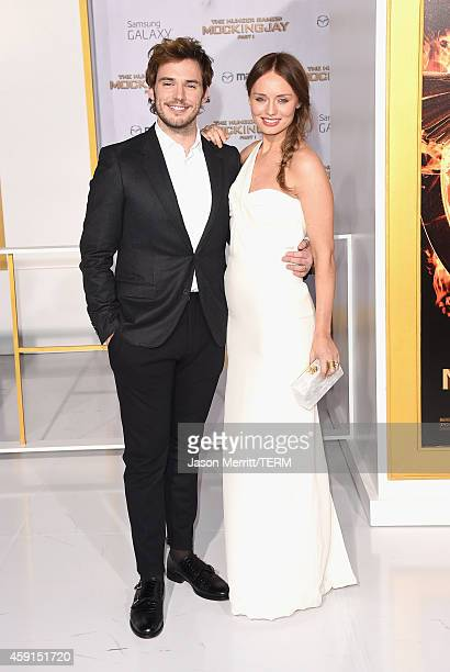 Actors Sam Claflin and Laura Haddock attend the Premiere of Lionsgate's 'The Hunger Games Mockingjay Part 1' at Nokia Theatre LA Live on November 17...