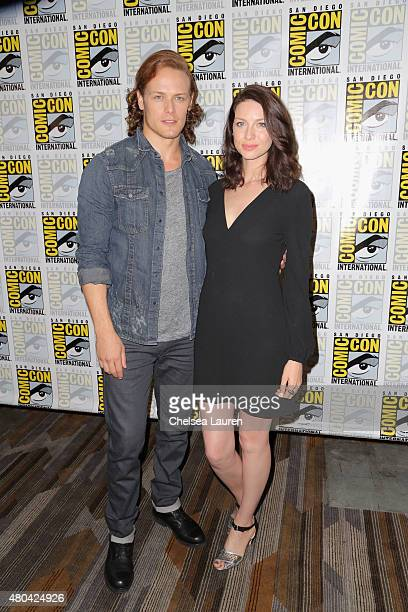 Actors Sam Heughan and Caitriona Balfe attend the 'Outlander' press room during ComicCon International 2015 at the Hilton Bayfront on July 11 2015 in...