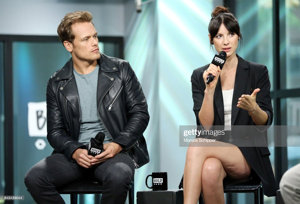 Actors Sam Heughan (L) and Caitriona Balfe discuss 'Outlander' at Build Studio on September 6, 2017 in New York City.