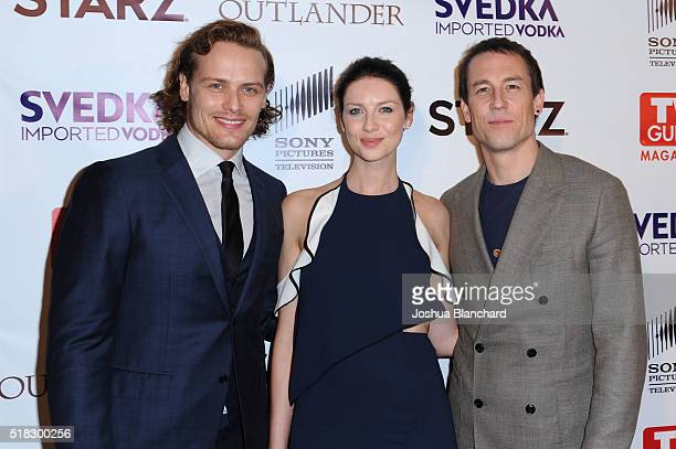 Actors Sam Heughan Caitriona Balfe and Tobias Menzies arrive at TV Guide Magazine celebrates STARZ's 'Outlander' at Palihouse on March 30 2016 in...