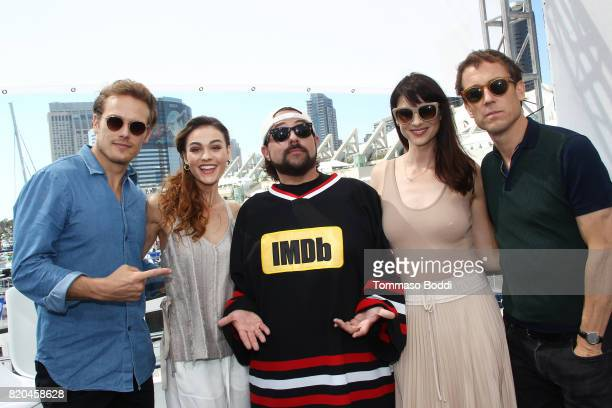 Actors Sam Heughan Sophie Skelton host Kevin Smith actors Caitriona Balfe and Tobias Menzies on the #IMDboat at San Diego ComicCon 2017 at The IMDb...