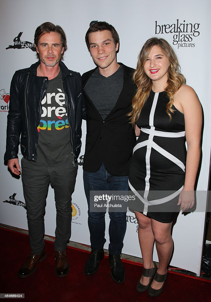 Actors <a gi-track='captionPersonalityLinkClicked' href=/galleries/search?phrase=Sam+Trammell&family=editorial&specificpeople=3205930 ng-click='$event.stopPropagation()'>Sam Trammell</a>, <a gi-track='captionPersonalityLinkClicked' href=/galleries/search?phrase=Nick+Krause&family=editorial&specificpeople=8221992 ng-click='$event.stopPropagation()'>Nick Krause</a> and Danielle Greenup attend the 'White Rabbit' premiere at The Laemmle Music Hall on February 13, 2015 in Beverly Hills, California.