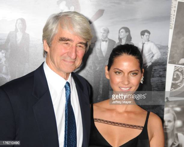 Actors Sam Waterston and Olivia Munn arrive at the Los Angeles Season 2 Premiere Of HBO's Series 'The Newsroom' at Paramount Studios on July 10 2013...