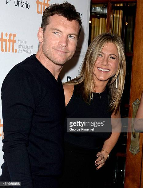 Actors Sam Worthington and actress/executive producer Jennifer Aniston attends the 'Cake' premiere during the 2014 Toronto International Film...