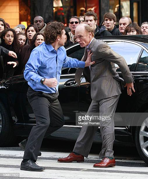 Actors Sam Worthington and Ed Harris are seen on the set of the movie ' Man on a Ledge' on location on the streets of Manhattan on November 14 2010...