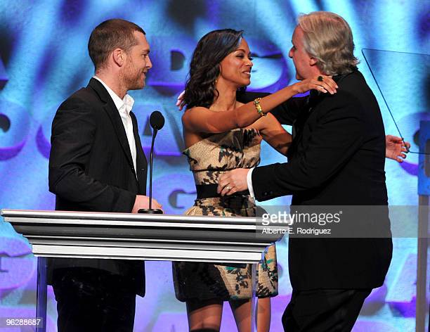 Actors Sam Worthington and Zoe Saldana present Director James Cameron the Feature Film Nomination Plaque for 'Avatar' onstage during the 62nd Annual...