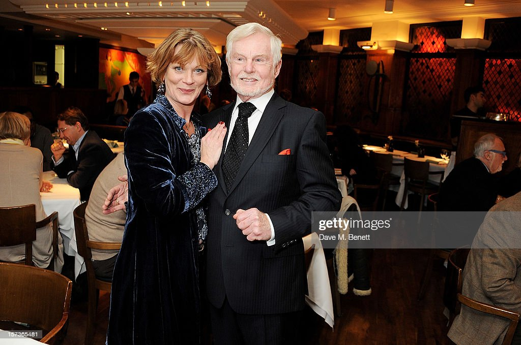 Actors Samantha Bond (L), working as a hostess, and Sir Derek Jacobi, working as Maitre D', attend One Night Only at The Ivy, featuring 30 stage and screen actors working as staff during dinner at The Ivy, in aid of The Combined Theatrical Charities, on December 2, 2012 in London, England.