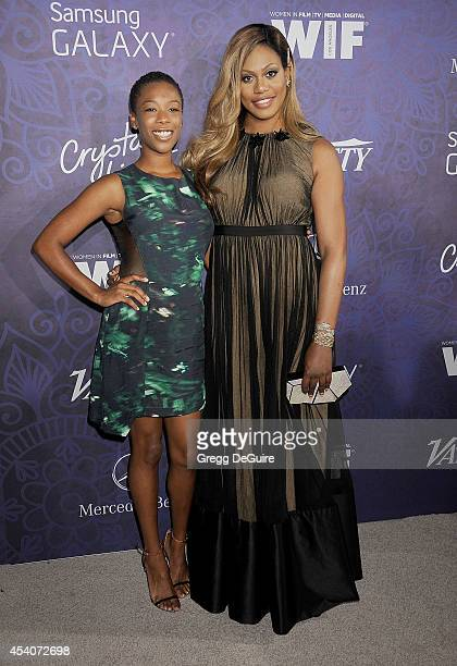 Actors Samira Wiley and Laverne Cox arrive at the Variety And Women In Film Annual PreEmmy Celebration at Gracias Madre on August 23 2014 in West...