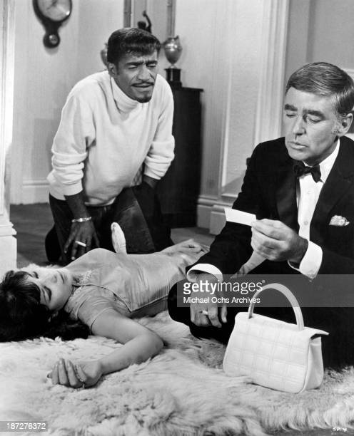 Actors Sammy Davis Jr and Peter Lawford with actress Jeanne Roland on set of the movie 'Salt and Pepper in 1968