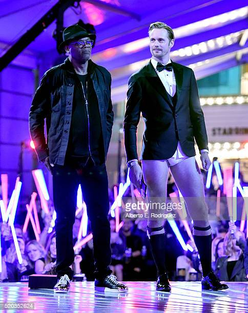 Actors Samuel L Jackson and Alexander Skarsgard speak onstage during the 2016 MTV Movie Awards at Warner Bros Studios on April 9 2016 in Burbank...