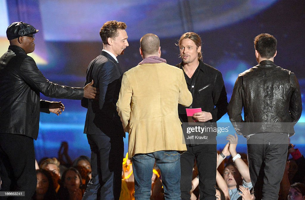 Actors Samuel L. Jackson, Tom Hiddleston, filmmaker Joss Whedon and Brad Pitt onstage during the 2013 MTV Movie Awards at Sony Pictures Studios on April 14, 2013 in Culver City, California.