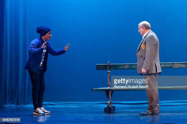Actors Samy Seghir and Michel Jonasz perform during 'Les Fantomes de la rue Papillon' Press Theater Play at Theatre du Gymnase MarieBell on February...
