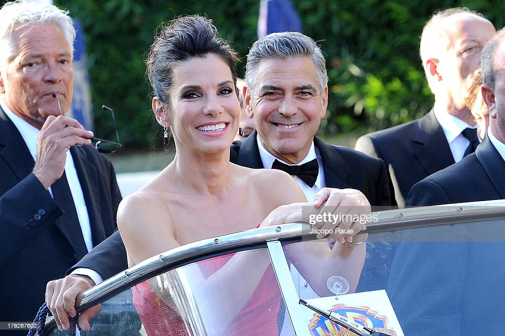 Actors <a gi-track='captionPersonalityLinkClicked' href=/galleries/search?phrase=Sandra+Bullock&family=editorial&specificpeople=202248 ng-click='$event.stopPropagation()'>Sandra Bullock</a> and <a gi-track='captionPersonalityLinkClicked' href=/galleries/search?phrase=George+Clooney&family=editorial&specificpeople=202529 ng-click='$event.stopPropagation()'>George Clooney</a> are seen during the 70th Venice International Film Festival on August 28, 2013 in Venice, Italy.