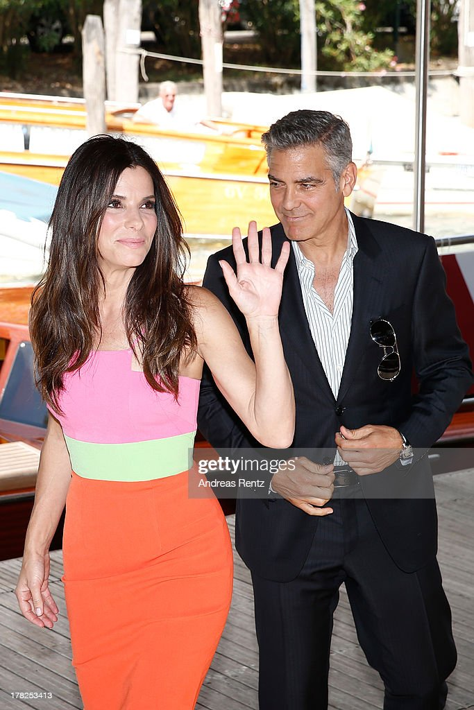 Actors Sandra Bullock and George Clooney arrive at the 'Gravity' photocall during the 70th Venice International Film Festival at the Palazzo del Casino on August 28, 2013 in Venice, Italy.