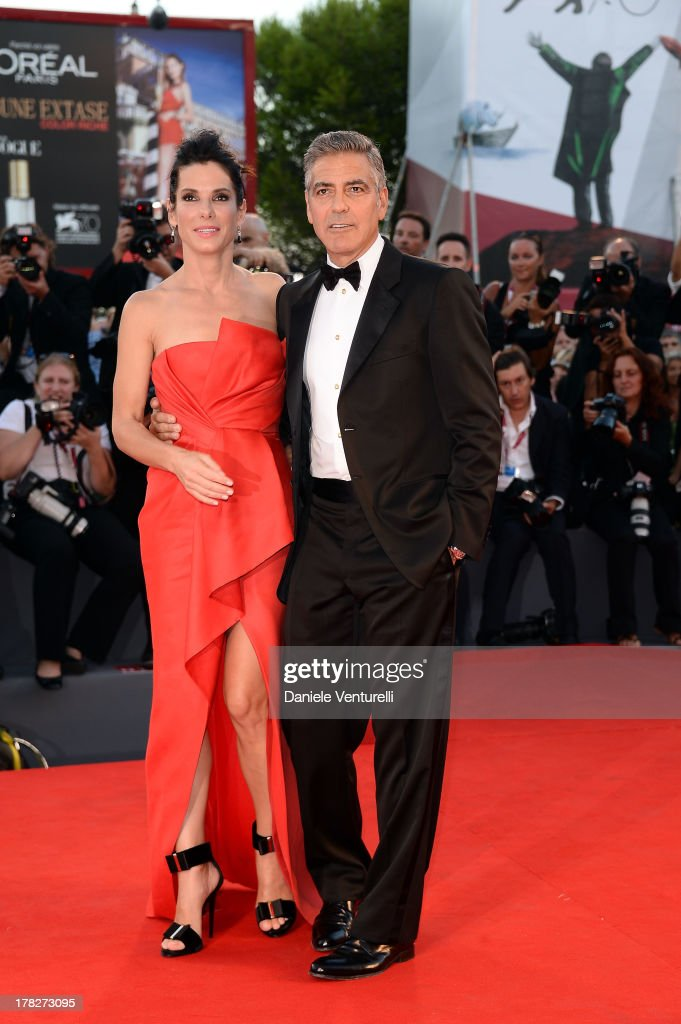 Actors Sandra Bullock and George Clooney attend 'Gravity' premiere and Opening Ceremony during The 70th Venice International Film Festival at Sala Grande on August 28, 2013 in Venice, Italy.